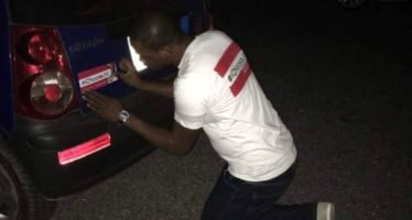 PHOTOS: NDC Youth Allegedly Stealing their Way to Paste JM Stickers on Cars
